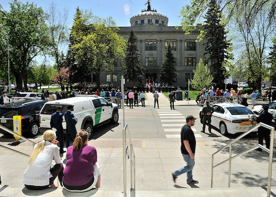 Attendants watch the National Police Week Memorial Service at Grand Forks County Court House May 17, 2016, in Grand Forks, N.D. The memorial service honored 35 local police officers who sacrificed their lives in the line of duty. (U.S. Air Force photo/Senior Airman Xavier Navarro)