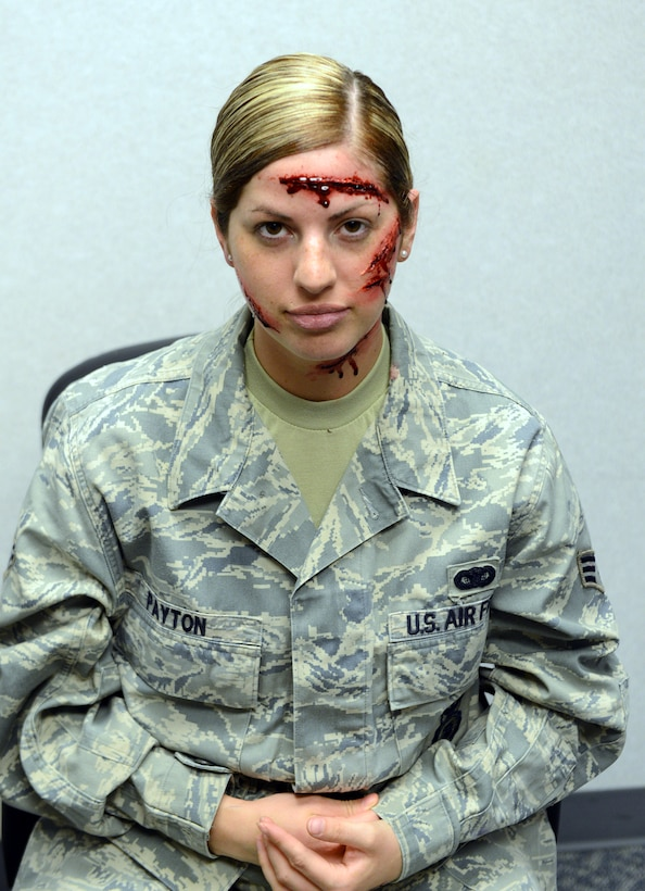 Senior Airman Shawnee Ryan, 78th Medical Support Squadron laboratory technician, shows off her moulage makeover. The name on her uniform is different because it's used for exercises. (U.S. Air Force photo by Tommie Horton)