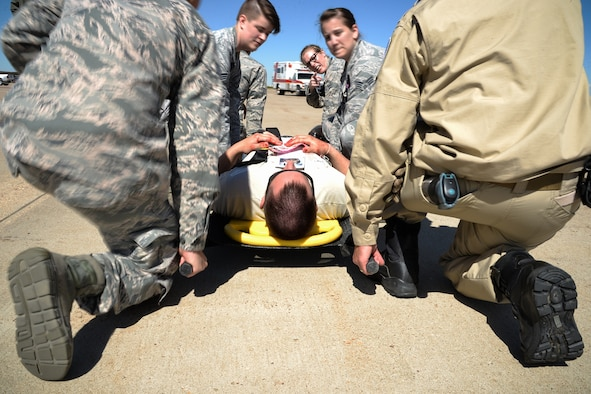 Emergency responders from Hill Air Force Base and the local community participate in a mass casualty exercise at the base, May 18, 2016. The exercise was held in preparation for the Warriors Over The Wasatch open house and air show to be held June 25-26 at Hill AFB.. (U.S. Air Force photo by R. Nial Bradshaw)