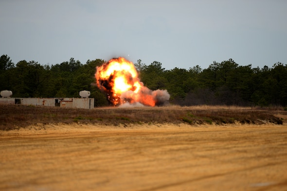 C-4 explosives are triple stacked and detonated on used BDU-50 500 lb. concrete-filled practice bombs to render them safe for recycling at Warren Grove Range in Ocean County, N.J. on April 29, 2016. U.S. Air Force Explosive Ordnance Disposal techs, civil engineers and range crew from the 177th Fighter Wing of the New Jersey Air National Guard and the 87th Civil Engineering Squadron at Joint Base McGuire-Dix-Lakehurst worked together during the annual EOD Week At The Range to perform range clean-up and target painting, as well as target set-up in the simulated village. (U.S. Air National Guard photo by Master Sgt. Andrew J. Moseley/Released)