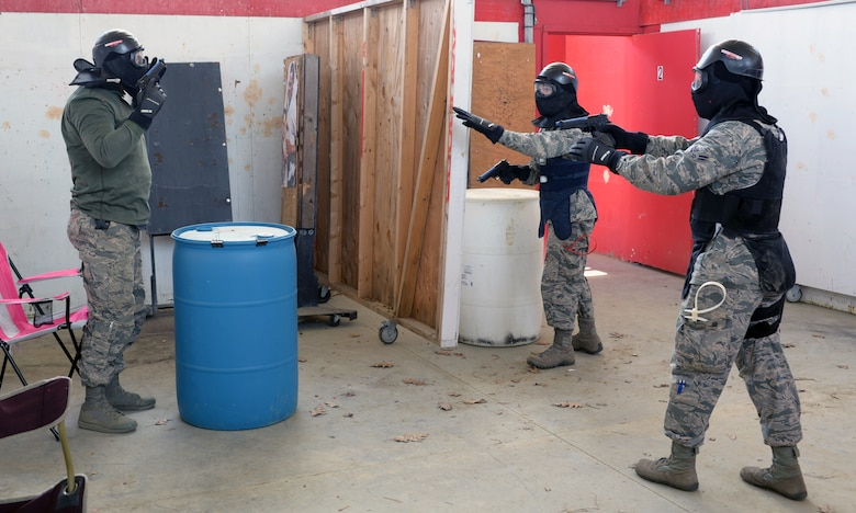 U.S. Air Force Airmen from the 157th Security Forces Squadron, attempt to detain Tech Sgt. Paul D. Lawrence II, 157 SFS unit training manager, right, during a use of force training scenario at Sig Sauer Academy, Epping, N.H. May 14, 2016. The personal protective equipment they are wearing provides them protection from the non-lethal training ammunition tipped with colored dye which they are using.  (U.S. Air National Guard photo by Airman 1st Class Ashlyn J. Correia)