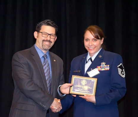 Master Sgt. Alice C. Nephew poses for a photo with Federal Executive Board of Minnesota (FEB) Chairman Dr. Michael T. Dutcher at the FEB Civil Servant of the Year awards banquet, May 5, 2016 at the Bloomington, Minn. Doubletree.  The award honors outstanding Minnesotan federal employees who have demonstrated exceptional performance and dedication both in the workplace and in the community. (Courtesy Photo/Released)