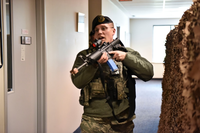 U.S. Air Force Tech. Sgt. Cody McLuckie, Security Forces specialist at the 180th Fighter Wing in Swanton, Ohio, searches a building for suspects and victims on base during an active shooter exercise on May 15, 2016. The 180th performed a base-wide active shooter response exercise and inspection to prepare Airmen to survive an incident on base or in their civilian lives. (Ohio Air National Guard photo by Tech. Sgt. Nic Kuetemeyer/released)