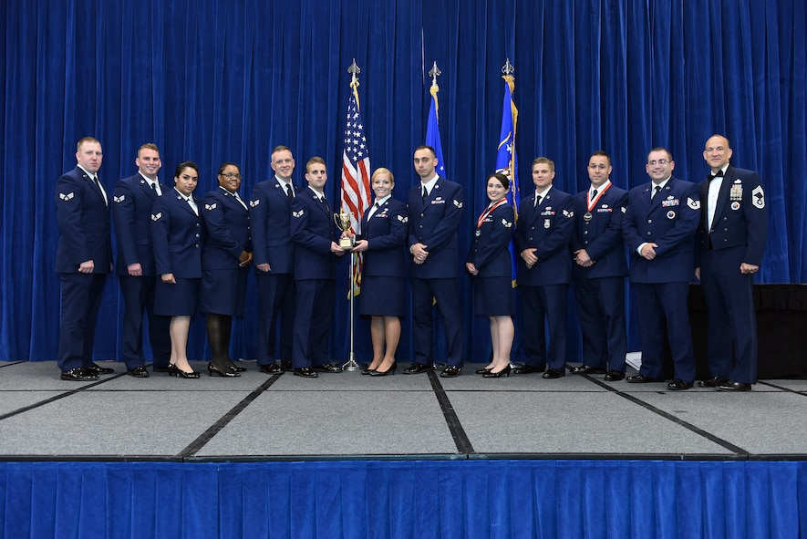 MCGHEE TYSON AIR NATIONAL GUARD BASE, Tenn. - Airmen in the B-Flight, take the honor flight award here, May 18, 2016, for the Airman leadership school, class 16-5, during the graduation banquet at the Chief Master Sgt. Paul H. Lankford Enlisted Professional Military Education Center. (U.S. Air National Guard photo by Master Sgt. Mike R. Smith/Released)