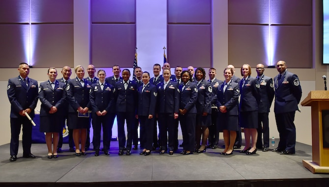 Twenty three members of Team Buckley received their Community College of the Air Force diplomas May 18, 2016, at the Leadership Development Center on Buckley Air Force Base, Colo. The college is a federally-chartered degree-granting institution established to provide the enlisted force an opportunity to extend their education in various career fields. (U.S. Air Force photo by Airman 1st Class Luke W. Nowakowski/Released)