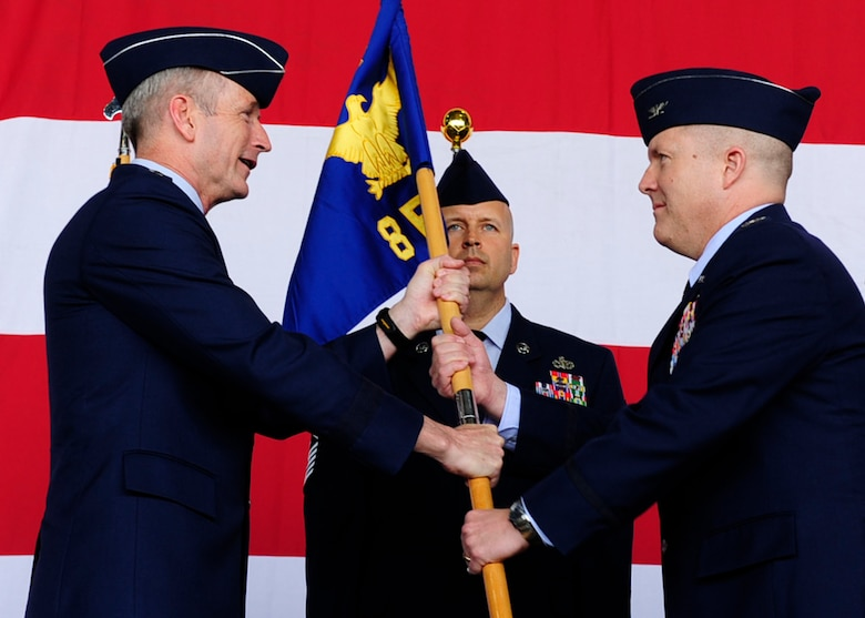 """Lt. Gen. Terrence O'Shaughnessy, 7th Air Force commander, transfers command to Col. Todd """"Wolf"""" Dozier, 8th Fighter Wing commander, during the 8th FW change of command ceremony at Kunsan Air Base, Republic of Korea, May 20, 2016. (U.S. Air Force photo by Staff Sgt. Chelsea Browning/Released)"""