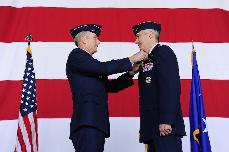 Lt. Gen. Terrence O'Shaughnessy, 7th Air Force commander, awards a Legion of Merit medal to Col. Jeremy Sloane, outgoing 8th Fighter Wing commander on Kunsan Air Base, Republic of Korea, May 20, 2016. (U.S. Air Force photo by Staff Sgt. Chelsea Browning/Released)