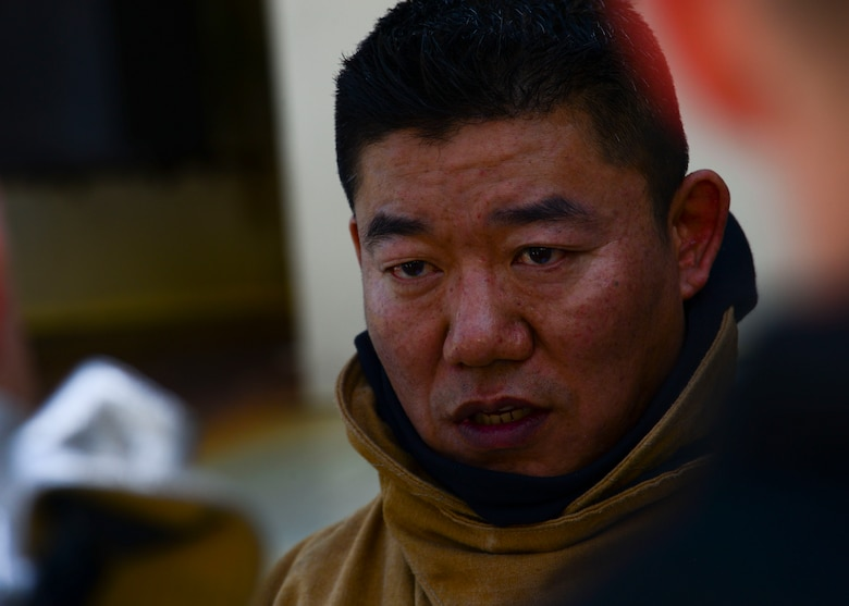 Master Sgt. Hungpyo Rucci, 51st Civil Engineer Squadron fire and emergency services flight assistant chief for health and safety, speaks to his team before live fire training at the Kyonggi-do Fire Academy, Republic of Korea, May 18, 2016. The firefighters were training with their Korean counterparts in their first off-base, live fire training. (U.S. Air Force photo by Senior Airman Victor J. Caputo/Released)