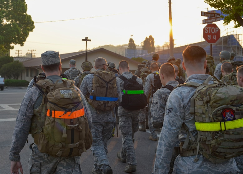 Members of Team Osan participate in a morning ruck march in commemoration of the Bataan Death March at Osan Air Base, Republic of Korea, May 20, 2016. The event, which was held as part of Asian-American and Pacific Islander Heritage Month, was hosted by the 607th Air Support Operations Group to honor the approximately 70,000 American and Filipino troops who were subject to a brutal transition after being captured by the Imperial Japanese Army during World War II. (U.S. Air Force photo by Senior Airman Victor J. Caputo/Released)