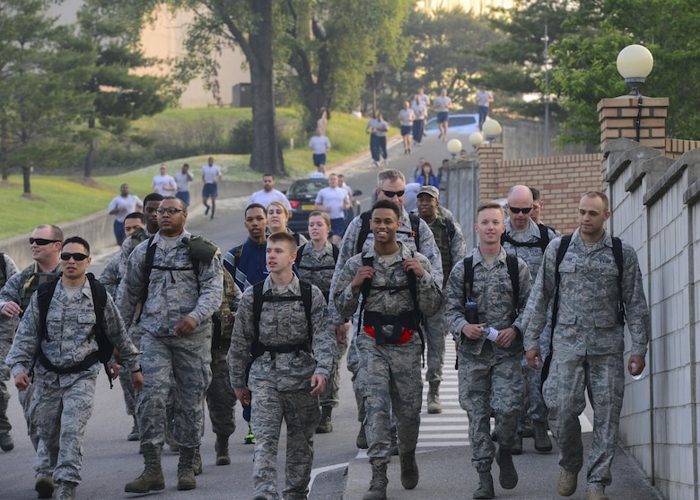 Members of Team Osan participate in a morning ruck march in commemoration of the Bataan Death March at Osan Air Base, Republic of Korea, May 20, 2016. The six-mile ruck march was held as part of Asian-American and Pacific Islander Month and in honor of the troops who suffered through the Bataan Death March during World War II. (U.S. Air Force photo by Senior Airman Victor J. Caputo/Released)