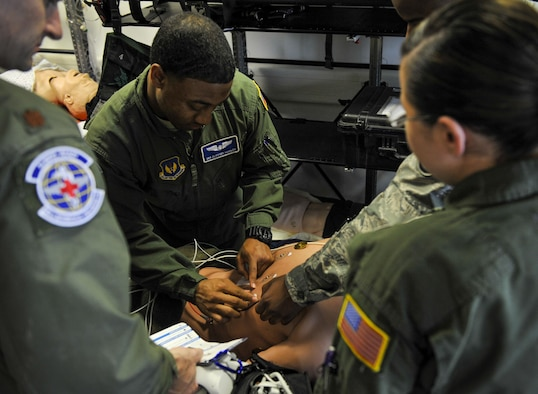 Senior Airman Clifford Hughley, 86th Aeromedical Evacuation Squadron technician (center), prepares a simulated patient for an electrocardiogram during an exercise May 12, 2016, at Ramstein Air Base, Germany. Though the nurses and technicians work a fast-paced job, they spent time out of the office during Nurses and Technicians Appreciation Week. (U.S. Air Force photo/Senior Airman Larissa Greatwood)