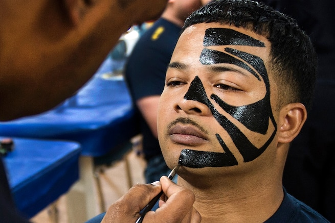 Navy Petty Officer 1st Class Ivan Mitchell gets his face painted to participate in a traditional Pacific Islander dance as part of a celebration to mark Asian American and Pacific Islander Heritage Month aboard the USNS Mercy in the Pacific Ocean, May 17, 2016. Navy photo by Petty Officer 2nd Class Hank Gettys