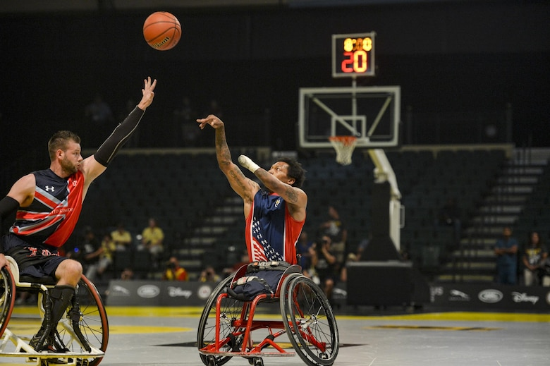 Retired U.S. Marine Corps Sgt. Anthony McDaniel shoots over a U.K. defender in the championship wheelchair basketball game at Invictus Games 2016 in Orlando, Fla., May 12, 2016. The 2016 Invictus Games were composed of 15 nations with over 500 military competitors competing in 10 sporting events from May 8-12. (U.S. Air Force photo/Tech. Sgt. Joshua L. DeMotts)