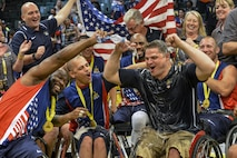 Team U.S. and Team U.K. celebrate after the wheelchair basketball championship match during the 2016 Invictus Games at the ESPN Wide World of Sports Complex in Orlando, Fla., May 12, 2016. The U.S. took gold and the U.K. took silver, while Denmark took home bronze. The next Invictus Game is scheduled to take place in Toronto. (U.S. Air Force photo/Senior Master Sgt. Kevin Wallace)