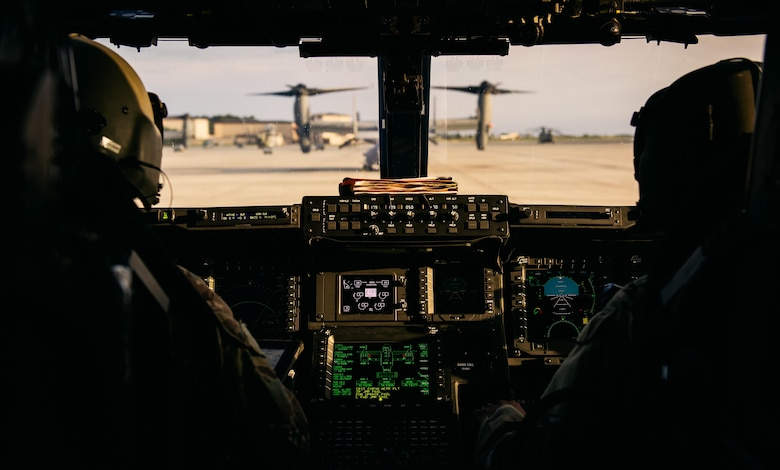 An Air Force and a Marine Corps CV-22 Osprey pilot assigned to the 8th Special Operations Squadron prepare for takeoff during exercise Emerald Warrior 16 on May 12, 2016, at Hurlburt Field, Fla. Emerald Warrior is a U.S. Special Operations Command-sponsored mission rehearsal exercise during which joint special operations forces train to respond to real and emerging worldwide threats. (U.S. Air Force photo/Senior Airman Jordan Castelan)