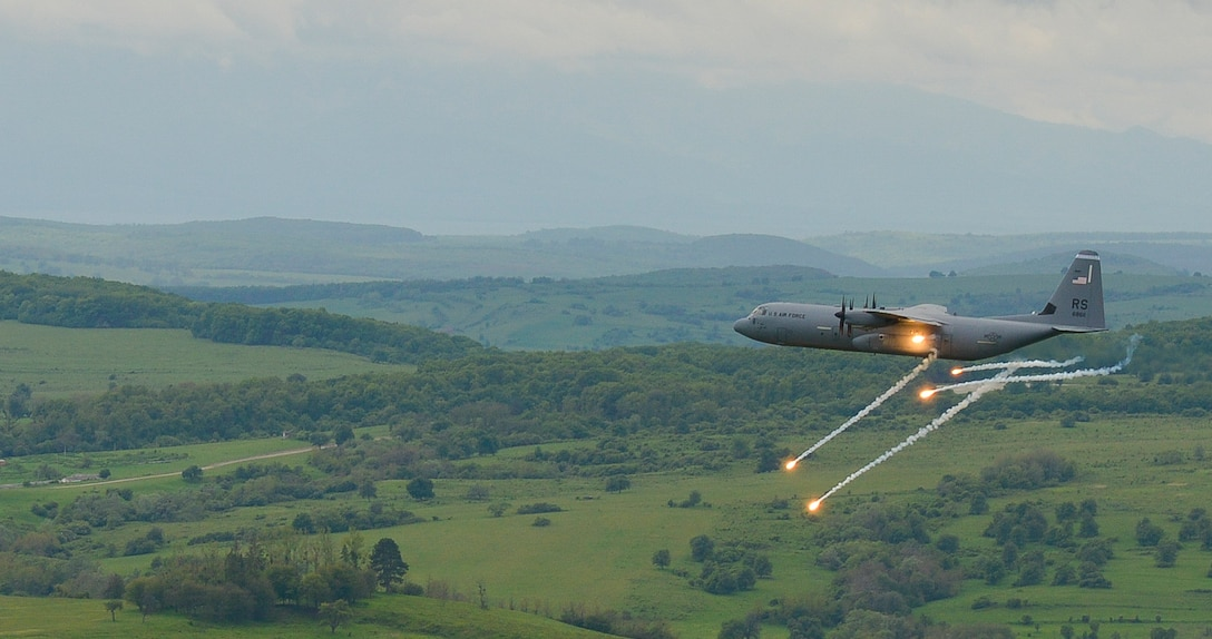 A C-130J Super Hercules from the 37th Airlift Squadron fires flares as it performs anti-aircraft fire tests during exercise Carpathian on May 9, 2016, in Romania. The 37th AS, from Ramstein Air Base, Germany, began participating in off-station training deployments with Romania as early as 1996, allowing the U.S. Air Force to work with NATO allies to develop and improve ready air forces capable of maintaining regional security. (U.S. Air Force photo/Airman 1st Class Lane Plummer)