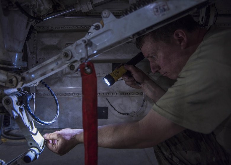 Tech. Sgt. Christopher Melrose, a 455th Expeditionary Aircraft Maintenance Squadron phase technician, inspects the interior of an F-16C Fighting Falcon during routine phase maintenance at Bagram Airfield, Afghanistan, May 18, 2016. The aircraft went through phase maintenance where members of the 455th EAMS phase flight closely inspected the aircraft for cracks and other types of damage, verifying that the 30-plus year old aircraft was safe to fly. (U.S. Air Force photo/Senior Airman Justyn M. Freeman)