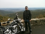 DLA employee Phil Prater stops at an overlook during a motorcycle ride through Skyline Drive, Virginia, Oct. 18, 2010.
