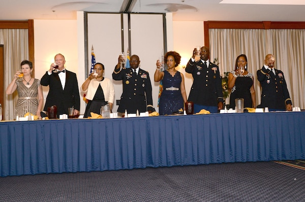 Members of the head table make a toast during a dining out May 14 at Joint Base Andrews, Maryland. The event was to say farewell to the outgoing commander, Army Col. Ralph Roper.
