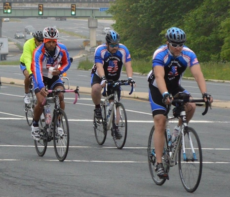 """DLA Police Staff Sgt. James Sprecher, second from right, rides for charity in the Law Enforcement United """"Road to Hope Memorial Bicycle Ride"""" May 10-12, 2016."""