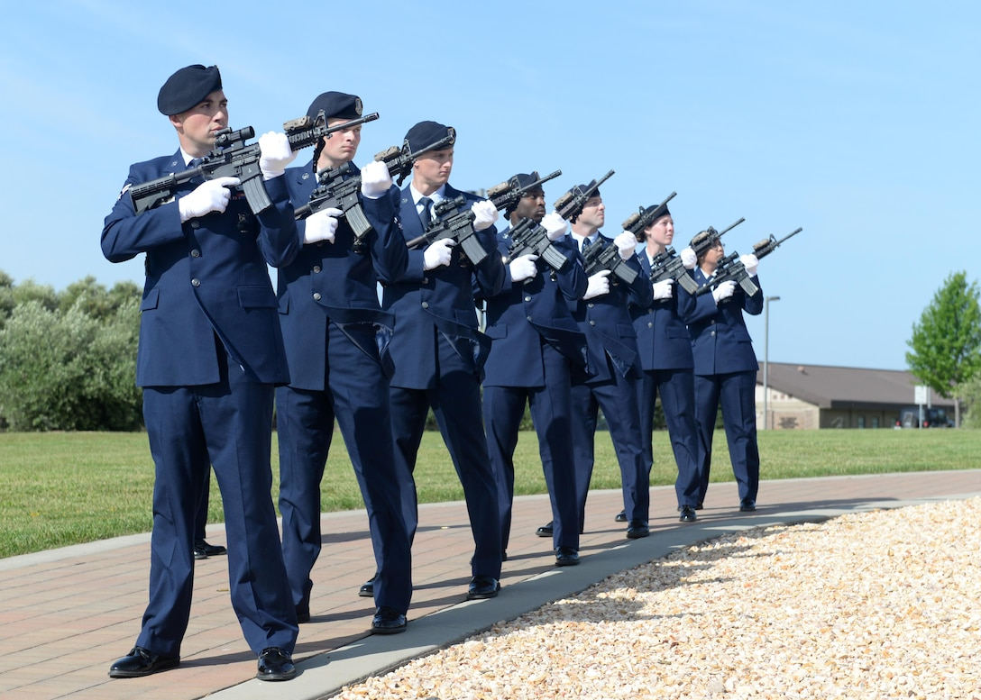 Members of the 9th Security Forces Squadron conduct a 21-gun salute during a memorial ceremony for National Police Week honoring fallen Security Forces Airmen and Air Force Office of Special Investigation members May 19, 2016, at Beale Air Force, California. (U.S. Air Force photo by Senior Airman Ramon A. Adelan)