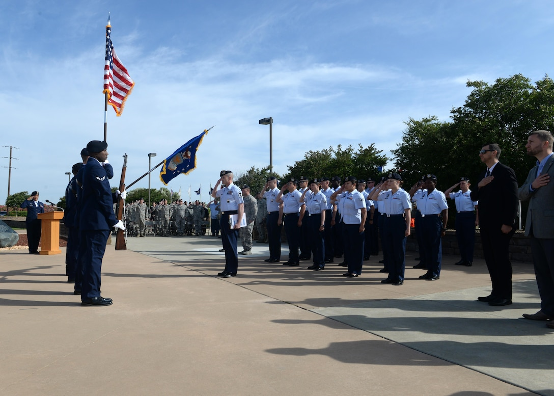 Members of the 9th Security Forces Squadron present the colors during a memorial ceremony for National Police Week honoring fallen Security Forces Airmen and Air Force Office of Special Investigation members May 19, 2016, at Beale Air Force, California. (U.S. Air Force photo/ Senior Airman Ramon A. Adelan)