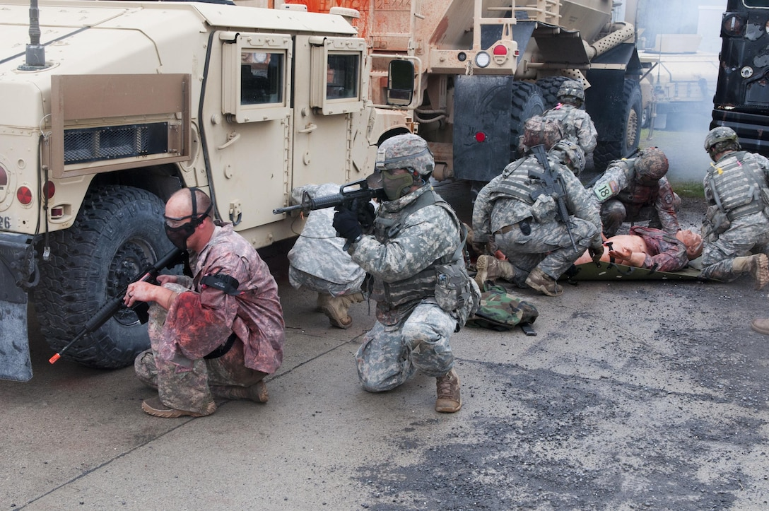Army engineer Soldiers compete in the Sapper Stakes 2016 by clearing a building and evacuating an injured member of their group during the competition at Fort Drum, New York, May 14.