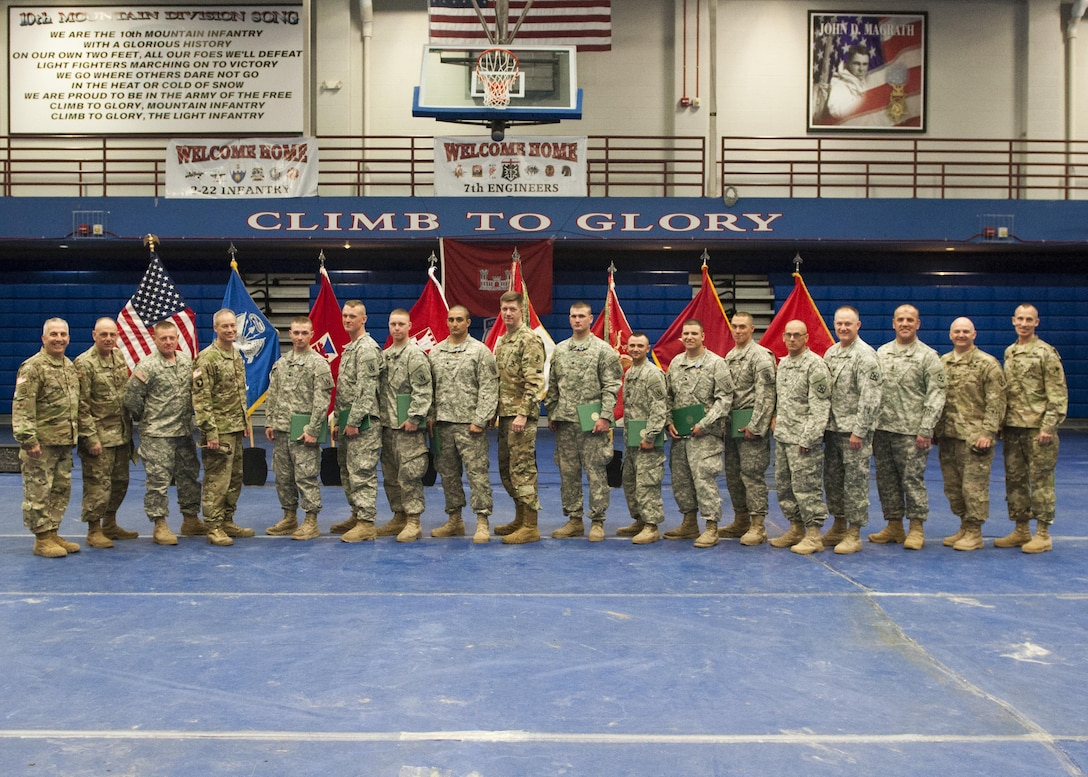 Army Soldiers Spc. Caleb S. Bailor, Sgt. Christian E. Cieslak, assistant team Leader, Spc. Dennis P. Kianka, Spc. Trevor P. Peden, Pvt. First Class Jacob L. Reed, Staff Sgt. Daniel R. Ryan, Pvt. First Class Kristoff D. Scherma, of the 382nd Engineer Company, 365th Engineer Battalion, 411th Engineer Brigade, 412th Theater Engineer Command, out of Harrisburg, Pennsylvania, are recognized for winning the 2016 Sapper Stakes competition at Fort Drum, New York, during the third year of the competition.