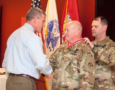U.S. Army Corps of Engineers, Transatlantic Division leaders presented the Bronze order of the deFleury Medal to Col. Stephen F. Dale in an award ceremony April 21.