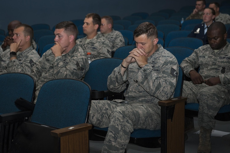 U.S. Air Force Airmen from the 23d Security Forces Squadron remember their fallen comrades as their names are recited during a retreat ceremony, May 20, 2016, at Moody Air Force Base, Ga. During the event, the names were read of all fallen Security Forces members since Operation Enduring Freedom, along with all fallen local law enforcement officers within the last year. (U.S. Air Force photo by Airman 1st Class Lauren M. Hunter/Released)