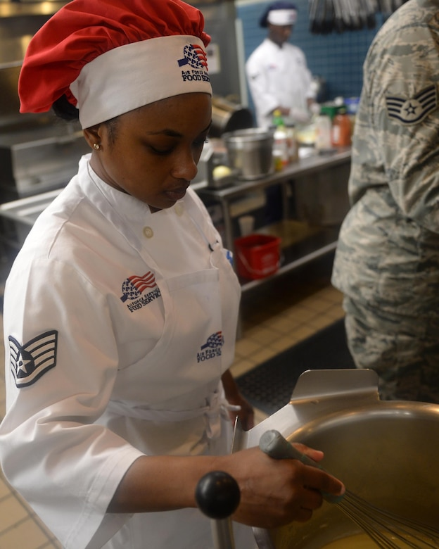 Staff Sgt. Jacquelyne Ford, 325th Force Support Squadron Berg-Liles Dining Facility (DFAC) shift leader, stirs a pot of broth being prepared for the dinner crowd at Tyndall Air Force Base, May 17. The DFAC provides hot, nutritious food service to more than 62,000 personnel annually in support of the Tyndall mission to train and project unrivaled combat air power. (U.S. Air Force photo by Airman 1st Class Cody R. Miller/Released)