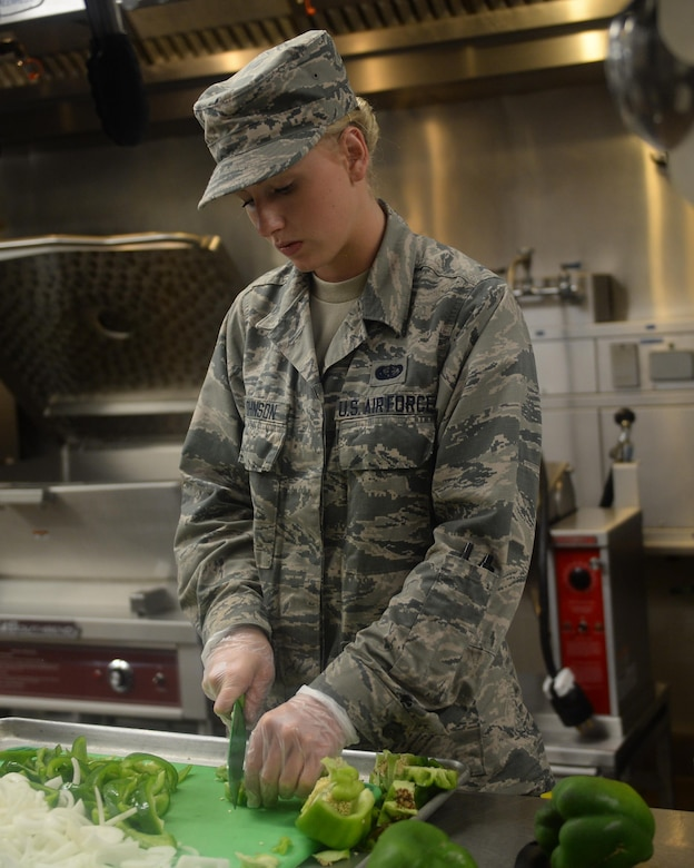 Airman Basic Carli Johnson, 325th Force Support Squadron Berg-Liles Dining Facility chef, chops bell peppers in preparation for a meal at Tyndall Air Force Base, May 17. Food service specialist like Johnson are trained to be knowledgeable in functions such as preparing, cooking, baking, presenting, and serving food. (U.S. Air Force photo by Airman 1st Class Cody R. Miller/Released)