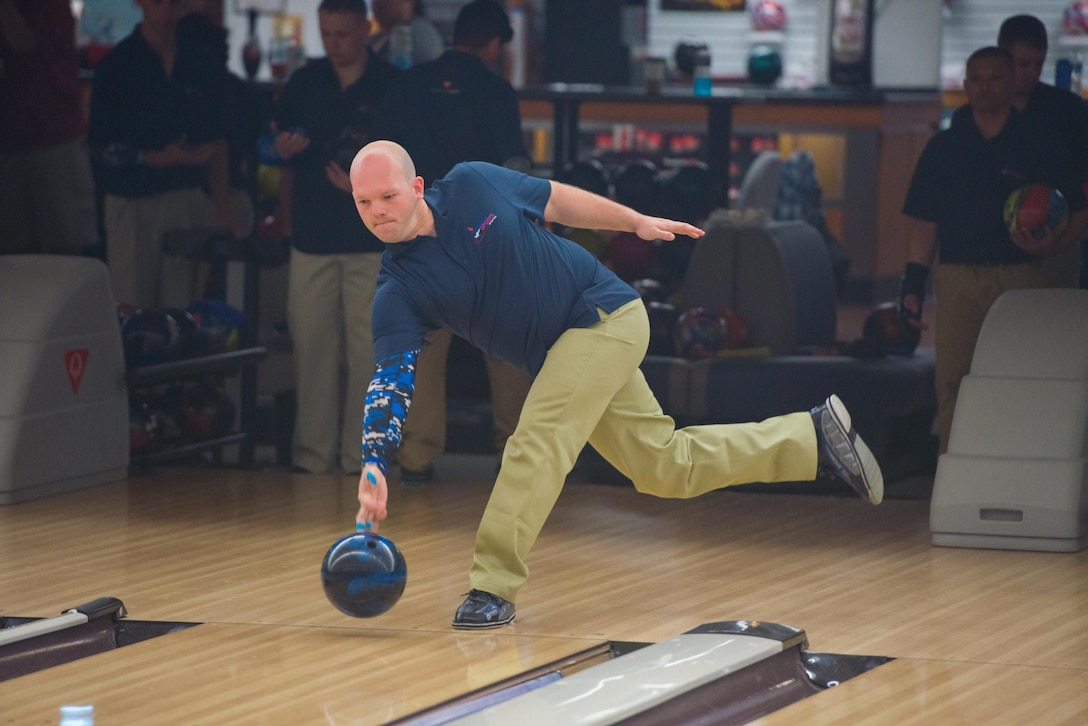 Technical Sergeant Kyle Wilkins, an RC-135 crew chief out of Offutt Air Force Base, Nebraska. warms up at the Armed Forces Bowling Championships at Travis Air Force Base, California (U.S. Air Foce Photo by Louis Briscese)