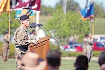 """Maj. Gen. Wayne W. Grigsby Jr., 1st Infantry Division and Fort Riley commanding general, speaks at a victory with honors ceremony May 12 at 1st Inf. Div. headquarters at Fort Riley. The ceremony was held in honor of Brig. Gen. John S. Kolasheski, the """"Big Red One's"""" deputy commanding general for maneuver, as he transitions to his new assignment as commandant at the U.S. Army Armor School at Fort Benning, Georgia."""