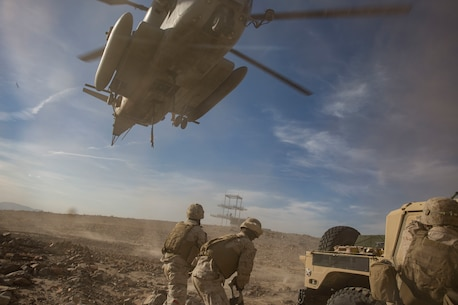 U.S Marines with 2nd Transportation Support Battalion (TSB), prepare to anchor ropes to a Humvee durring the Integrated training exercise (ITX) on 29 Palms, Ca., May. 13, 2016. 2nd TSB and subordinate units participated in ITX 3-16 to ensure all elements of Special-Purpose Marine Air Ground Task Force 2 are prepared for upcoming deployments and operational commitments.