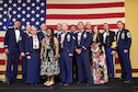 Air Force Special Operations Command Commander Lt. Gen. Brad Heithold, left, and U.S. Special Operations Command Command Sgt. Maj. William Thetford, second from right, celebrate AFSOC's 2016 outstanding Airmen and civilians of the year during a banquet at Hurlburt Field, May 19, 2016. The award winners toured Hurlburt Field May 17 and 18  before being honored at the yearly awards banquet held May 19 to celebrate their accomplishments. (U.S. Air Force photo by Senior Airman Jeff Parkinson)