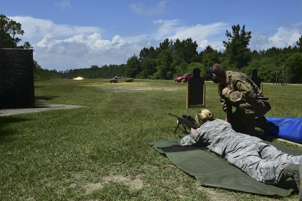 Maj. Martie Fredericks-Lenhart, a strategic analyst with the Air Force Special Operations Command Operations Center, fires a sniper rifle, May 18, 2016. The award winners toured Hurlburt Field May 17 and 18  before being honored at the yearly awards banquet held May 19 to celebrate their accomplishments. (U.S. Air Force photo by Senior Airman Jeff Parkinson)