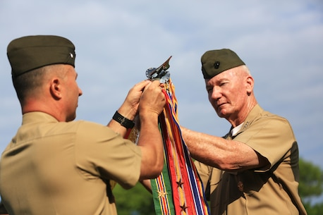Lt. Gen. John A. Toolan, commander, U.S. Marine Corps Forces, Pacific and Col. Peter S. Gadd, Headquarters and Service Battalion commanding officer, MARFORPAC, attach a Meritorious Unit Commendation streamer to the colors during a battalion formation on Camp H.M. Smith, Hawaii, May 6, 2016. The formation was held to award the Marines of MARFORPAC a Meritorious Unit Commendation, the shooting team the Master Gunnery Sgt. Michael T. Finn trophy for winning the Pacific Division pistol matches, and the MARFORPAC Band the U.S. Marine Corps Band of the Band of the Year trophy.