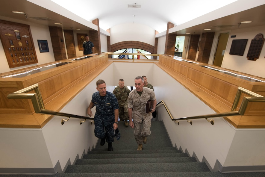 Marine Corps Gen. Joe Dunford, front right, chairman of the Joint Chiefs of Staff, walking with Navy Rear Adm. Randy B. Crites, commander of Submarine Group 10.