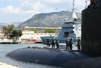 A sailor aboard the USS Springfield heaves a shot line as the submarine prepares to moor pier side during a scheduled port visit in Toulon, France, May 17, 2016. The Springfield is supporting U.S. national security interests in Europe.  Navy photo