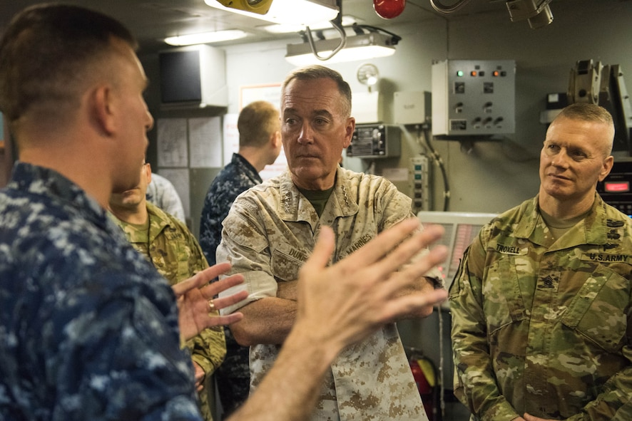 Marine Corps Gen. Joe Dunford, chairman of the Joint Chiefs of Staff, and Army Command Sgt. Maj. John W. Troxell, right, the chairman's senior enlisted advisor, receiving a briefing.