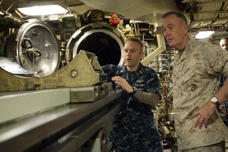 Marine Corps Gen. Joe Dunford, chairman of the Joint Chiefs of Staff, receiving a briefing on the torpedo system.