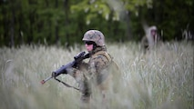 Lance. Cpl. Rebecca Brewer, military police, with 4th Law Enforcement Battalion, Force Headquarters Group, Marine Forces Reserve, patrols through high grass during exercise Platinum Wolf 2016 at Peacekeeping Operations Training Center South Base, Bujanovac, Serbia, May 16, 2016. The Marines joined partner nations from Bosnia, Bulgaria, Macedonia, Montenegro, Slovenia and Serbia to train in patrolling, cordon and search operations, peacekeeping operations, and non-lethal weapons.