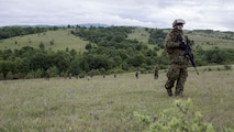 Reserve Marines with 4th Law Enforcement Battalion, Force Headquarters Group, Marine Forces Reserve, patrol the Serbian countryside during exercise Platinum Wolf 2016 at Peacekeeping Operations Training Center South Base, Bujanovac, Serbia, May 16, 2016. The Marines are working with the partner nations of Bosnia, Bulgaria, Macedonia, Montenegro, Slovenia and Serbia to share new ideas, build interoperability, and master peacekeeping operations.