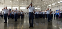 Col. Brandon Parker, 2nd Bomb Wing vice commander, leads a flight of Airmen in a salute to Col. Ty Neuman during a change of command ceremony at Barksdale Air Force Base, La., May 20, 2016. As commander, he will be charged with promoting the welfare of more than 11,400 military and civilian personnel, 6,300 family members and 25,000 retirees. (U.S. Air Force photo/Senior Airman Curt Beach)