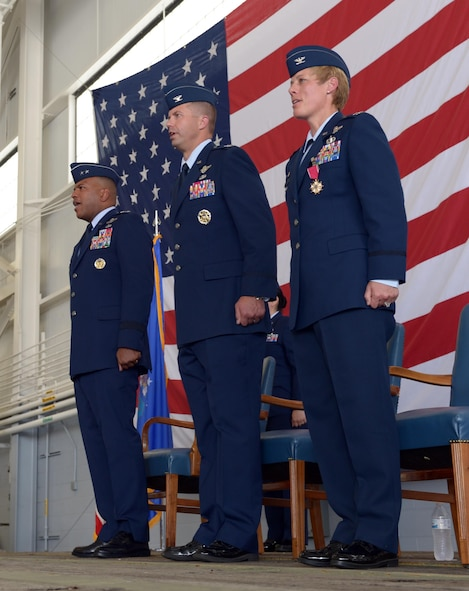 Maj. Gen. Richard Clark, 8th Air Force commander, Col. Ty Neuman, 2nd Bomb Wing incoming commander, and Col. Kristin Goodwin, 2BW outgoing commander, sing the Air Force song after a change of command ceremony at Barksdale Air Force Base, La., May 20, 2016. Neuman replaced Goodwin as commander of the 2nd BW and will be charged with promoting the welfare of more than 11,400 military and civilian personnel, 6,300 family members and 25,000 retirees. (U.S. Air Force photo/Senior Airman Curt Beach)