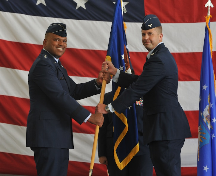 Col. Ty Neuman assumes command of the 2nd Bomb Wing during a change of command ceremony at Barksdale Air Force Base, La., May 20, 2016. As commander, he will support 32 tenant units, including headquarters Air Force Global Strike Command, headquarters 8th Air Force and Air Force Reserve Command's 307th Bomb Wing. (U.S. Air Force photo/Senior Airman Joseph Raatz)