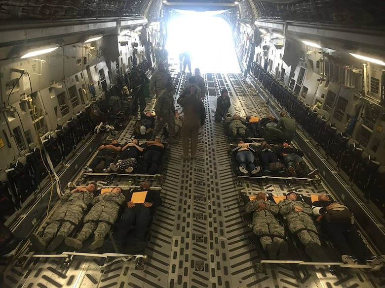 Simulated patients lay on gurneys in a C-17 Globemaster III aircraft, operated by the 167th Airlift Wing, during a disaster response exercise, at Naval Air Station-Joint Reserve Base New Orleans, La., April 14-16. The exercise was in conjunction with the nationwide Vigilant Guard exercise. (U.S. Air National Guard photo by Capt. Sam Harrison/released)