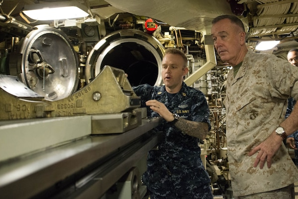 Marine Corps Gen. Joe Dunford, chairman of the Joint Chiefs of Staff, receives a briefing on the torpedo system aboard the USS Alaska at Naval Submarine Base Kings Bay, Ga., May 20, 2016. DoD photo by D. Myles Cullen