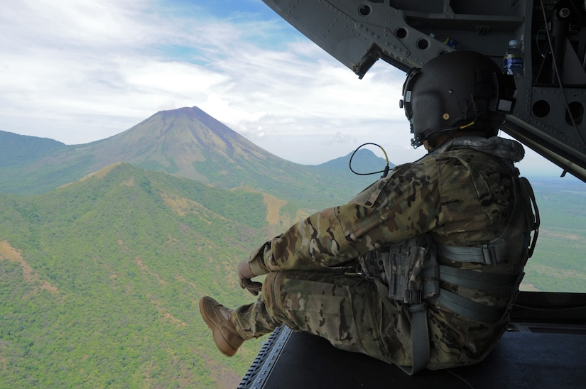 U.S. Army Sgt. King David, 1st Battalion, 228th Aviation Regiment CH-47 Chinook Crew Chief, observes the San Cristóbal volcano, one of at least six active volcanos in Nicaragua, while transporting the Joint Task Force-Bravo U.S. Southern Command Situational Assessment Team from Managua, Nicaragua and Soto Cano Air Base, Honduras, May 19, 2016. The S-SAT, which is a scalable element comprised of a team leader, civil military operations officer, air operations planer, engineer operations planner, logistics planner, communications planner, medical planner and force protection planner, who provide critical information to governmental and non-governmental disaster response teams so they know what to expect and plan for when they arrive. The JTF-Bravo S-SAT was invited to Nicaragua to demonstrate their ability to respond to a disaster situation and integrate with the U.S. Embassy, Managua, Community Emergency Response Team and the Nicaraguan National System for Prevention and Attention to Disasters (SINAPRED) to aid in the response and alleviate human suffering. (U.S. Air Force Photo by Capt. David Liapis)